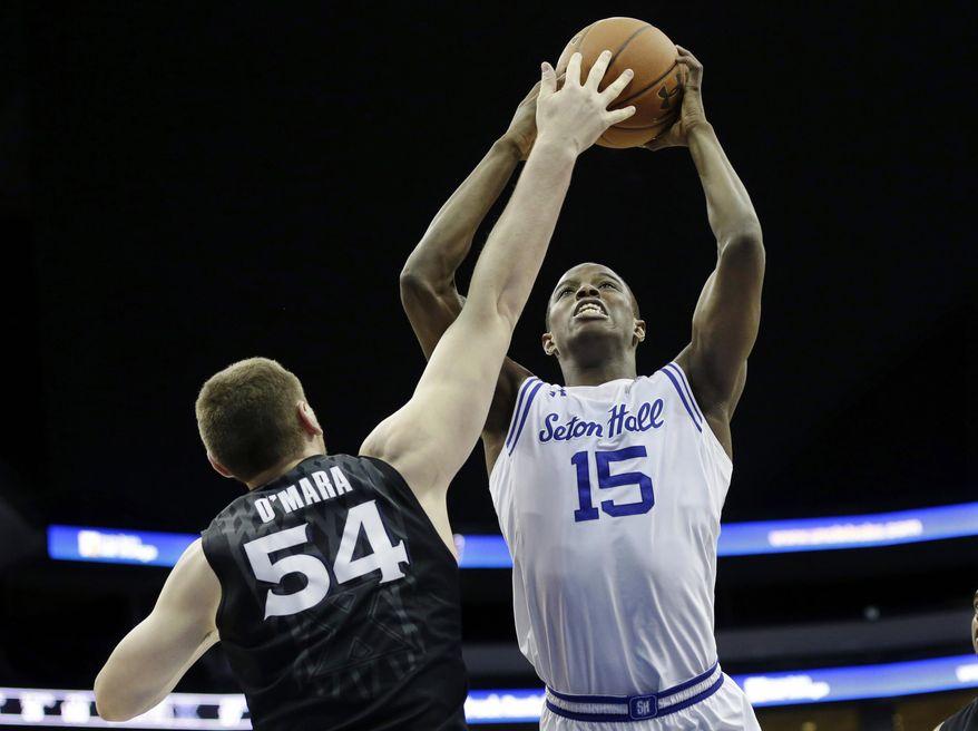 Seton Hall guard Isaiah Whitehead (15) shoots past Xavier forward Sean O'Mara (54) during the first half of an NCAA college basketball game Sunday, Feb. 28, 2016, in Newark, N.J. (AP Photo/Mel Evans)