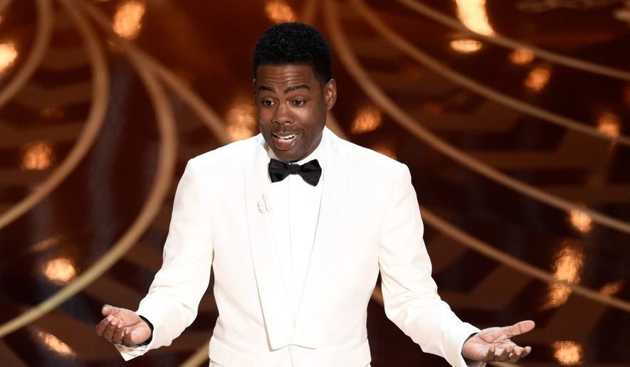 "Host Chris Rock opened the Oscars Sunday on the controversy sparked by all 20 nominated actors being white for the second consecutive yar, touching on the matter while also attempting to make light of it, saying ""I'm here at the Academy Awards, otherwise known as the White People's Choice Awards."" (Associated Press Photographs)"