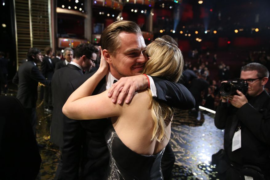 """Leonardo DiCaprio, winner of the award for best actor in a leading role for """"The Revenant"""", left,  embraces Kate Winslet backstage at the Oscars on Sunday, Feb. 28, 2016, at the Dolby Theatre in Los Angeles. (Photo by Matt Sayles/Invision/AP)"""