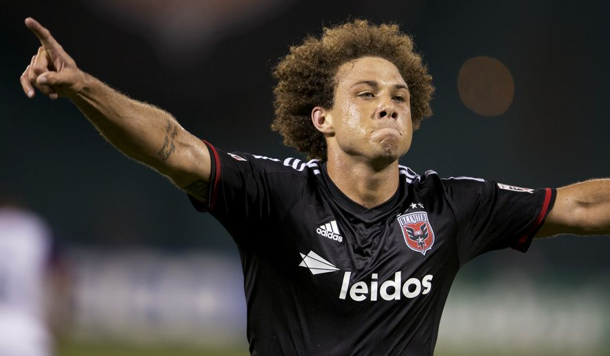 D.C. United midfielder Nick DeLeon glides after scoring during the second half of an MLS soccer match against the Real Salt Lake in Washington, Saturday, Aug. 1, 2015.    (AP Photo/Manuel Balce Ceneta)