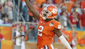 \Clemson cornerback Mackensie Alexander (2) celebrates a play during the first half of the Orange Bowl NCAA college football semifinal playoff game against  Oklahoma, Thursday, Dec. 31, 2015, in Miami Gardens, Fla.  (AP Photo/Lynne Sladky)
