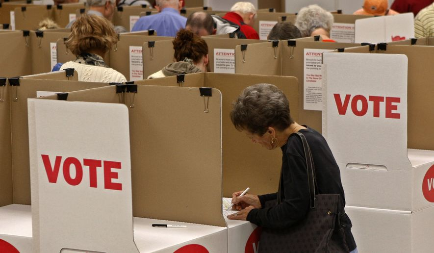 FILE - In this Friday, Oct. 29, 2010 file photo, Luella Lingenfelter marks her ballot at the Oklahoma County Election Board during early voting in Oklahoma City. Both Bernie Sanders and Hillary Clinton campaigns are reaching out to independents, who for the first time will be allowed to vote in Oklahoma's Democratic primary. (AP Photo/Sue Ogrocki, File)