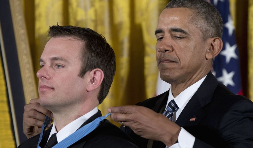 President Barack Obama presents the Medal of Honor to Senior Chief Special Warfare Operator Edward Byers during a ceremony in the East Room of the White House, in Washington, Monday, Feb. 29, 2016. U.S. Navy. (AP Photo/Carolyn Kaster)
