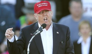 Republican presidential front-runner Donald Trump on Monday forcefully pushed back against TV ads accusing him of ripping off students at Trump University real estate school, releasing student surveys giving the program rave reviews. (Associated Press)