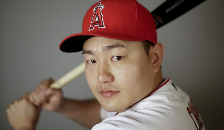 FILE - In this Feb. 26, 2016, file photo,  Ji-Man Choi of the Los Angeles Angels baseball team, poses in Tempe, Ariz. Ji-Man Choi didn't become a swtich-hitter until midway through last season. His remarkable mid-career adjustment could make him part of the Los Angeles Angels' patch for their hole in left field.  (AP Photo/Chris Carlson, File)