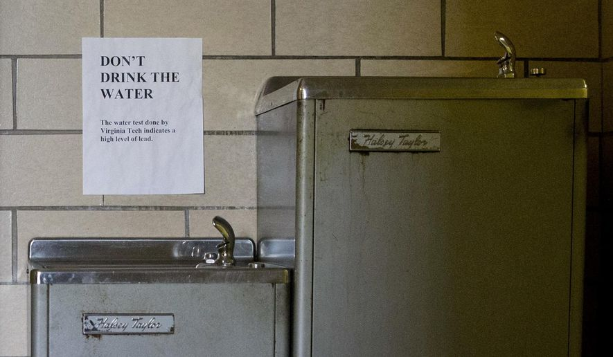 FILE--In this Feb. 25, 2016 file photo, signs warn not to drink the lead contaminated water from a water fountain at Woodside Church in Flint, Mich. The Obama administration said Monday, Feb. 29, 2016 it would keep a closer watch on state agencies in charge of drinking water safety, urging them to prevent more cases such as Flint, where the system has been tainted with lead. In addition to double-checking their procedures for treatment and sampling, the U.S. Environmental Protection Agency said states should bolster confidence in public water systems by making information such as lead and copper testing results and the location of lead water pipes available online.(AP Photo/Jacquelyn Martin, file)