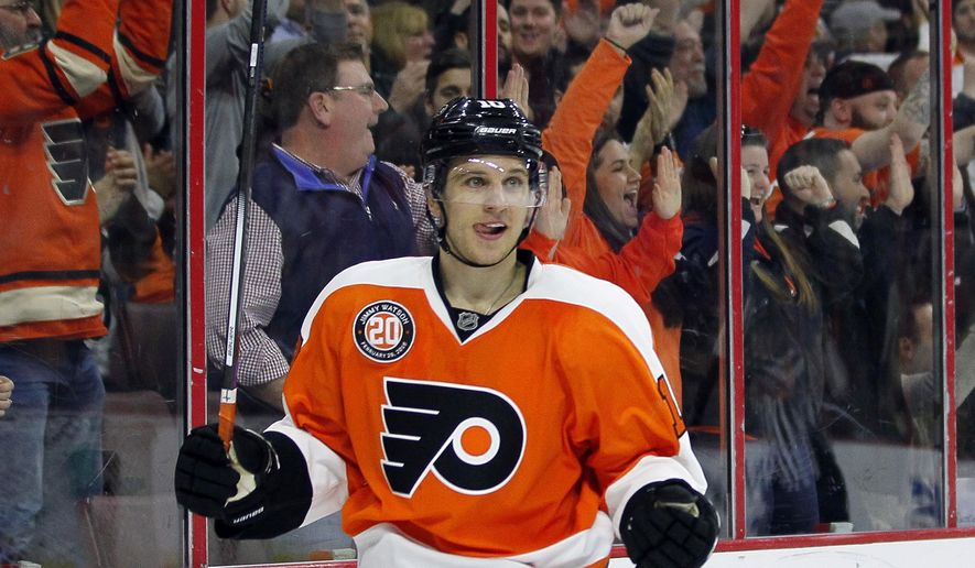 Philadelphia Flyers' Brayden Schenn reacts after scoring during the second period of an NHL hockey game against the Calgary Flames on Monday, Feb. 29, 2016 in Philadelphia. (AP Photo/Tom Mihalek)