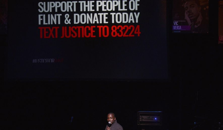 "In this Sunday, Feb. 28, 2016 photo,  Host Hannibal Buress speaks at the #JusticeForFlint event in Flint, Mich. The benefit for residents affected by the lead-contaminated water crisis in Flint featured some big names but is a grass-roots effort at its core, ""Creed"" director Ryan Coogler said Sunday. (Conor Ralph/The Flint Journal-MLive.com via AP) LOCAL TELEVISION OUT; LOCAL INTERNET OUT; MANDATORY CREDIT"
