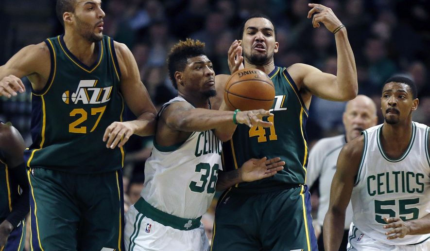 Boston Celtics' Marcus Smart (36) and Utah Jazz's Trey Lyles (41) battle for a loose ball during the second quarter of an NBA basketball game in Boston, Monday, Feb. 29, 2016. (AP Photo/Michael Dwyer)