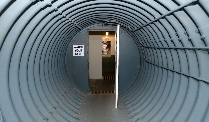 In this photo taken Friday, Feb. 26, 2016, the door where entrants would have checked themselves with Geiger counters and, if radioactive, stripped and showered in President John F. Kennedy's bunker on Peanut Island in Riviera Beach, Fla. The bunker where President Kennedy would have been whisked if World War III erupted while he vacationed in Florida may face a bigger threat than Soviet missiles ever posed: a battle between its operators and the Port of Palm Beach. (AP Photo/Alan Diaz)