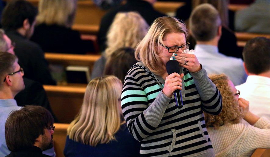 A friend of Mary Jo Nye wipes tears away before continuing to speak at a memorial service honoring Nye, a victim of Kalamazoo's Feb. 20 multiple shootings, at Chapel Hill United Methodist Church in Battle Creek, Mich. Sunday, Feb. 28, 2016. (Chelsea Purgahn/Kalamazoo Gazette via AP)