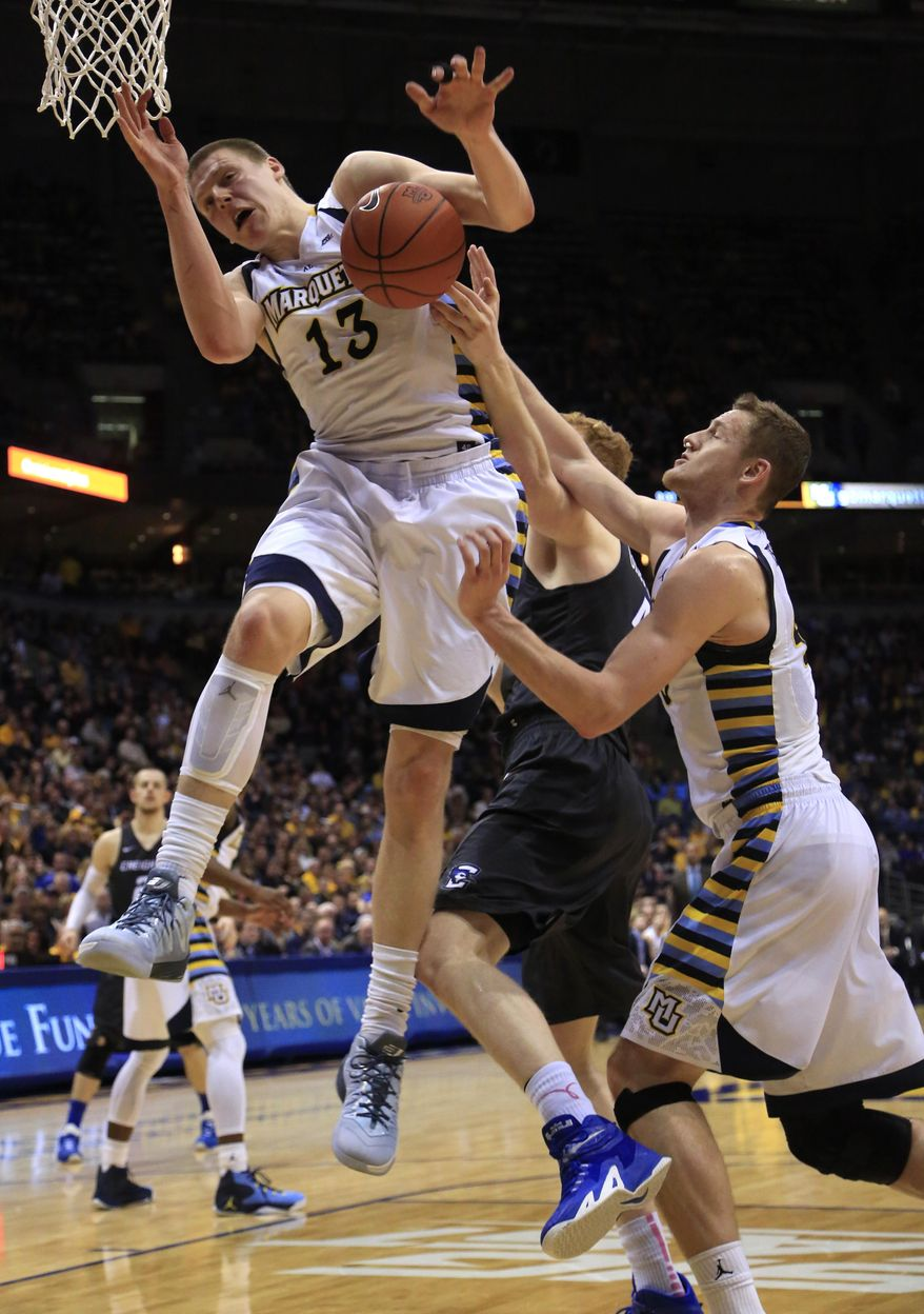 FILE - In this Feb. 13, 2016, file photo, Marquette forward Henry Ellenson, left, and Luke Fischer, right, defend against Creighton center Geoffrey Groselle, center, during the second half of an NCAA college basketball game, in Milwaukee. Freshman forward Henry Ellenson will have left a lasting impression at Marquette, even if he doesn't play another game at the Bradley Center for the Golden Eagles after Tuesday's, March 1, 2016, regular-season home finale. (AP Photo/Darren Hauck, File)
