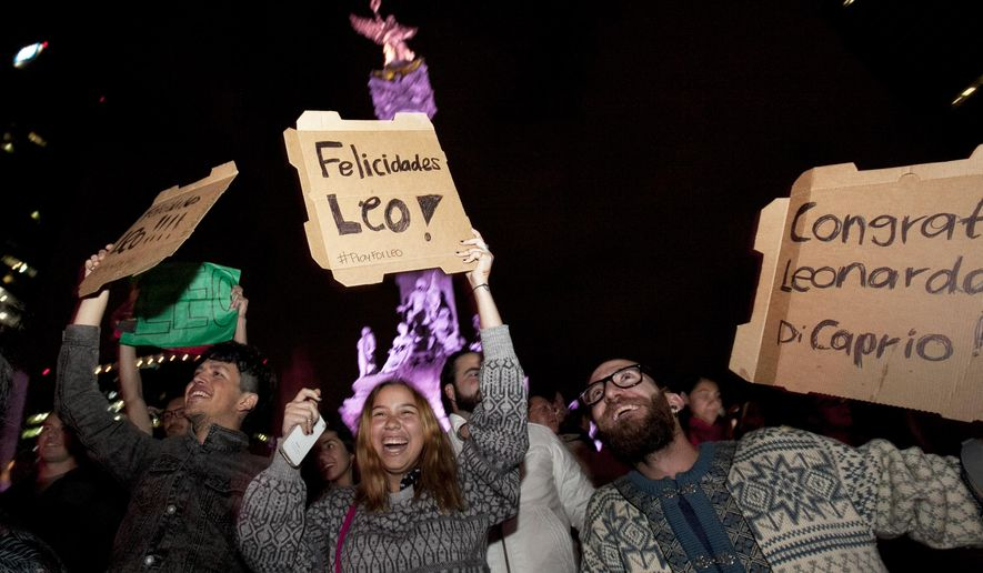 "Fans celebrate the Oscar win for US actor Leonardo DiCaprio, who won in the Best Actor in a Leading Role category for ""The Revenant,"" at the Angel of Independence monument in Mexico City, Sunday, Feb. 28, 2016. The revelers were chanting in Spanish ""Leo, brother you are Mexican now!"" (AP Photo/Marco Ugarte)"