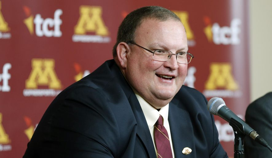 FILE - In this Nov. 11, 2015, file photo, Newly named University of Minnesota head football coach Tracy Claeys is introduced to a news conference in Minneapolis. Spring practice has arrived for Minnesota, making the takeover of the Gophers program official for head coach Claeys. (AP Photo/Jim Mone, File)