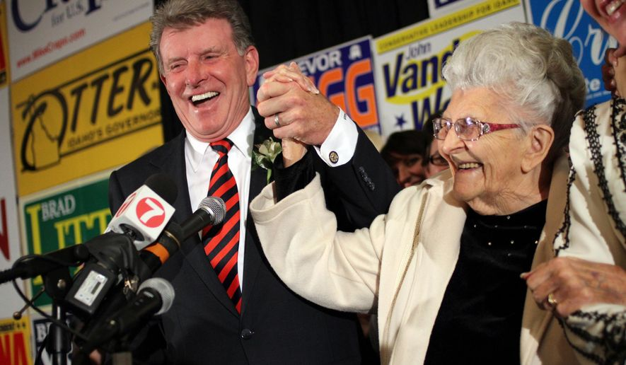 "FILE - In this Nov. 2, 2010 file photo, Idaho Gov. C.L. ""Butch"" Otter celebrates with his mother Regina Otter while addressing supporters at the Idaho Republican election night headquarters in Boise. Regina Otter, passed away this weekend in southwest Idaho at age 101. Spokesman Jon Hanian said Monday, Feb. 29, 2016, the governor will likely be out of the office for the next few days. The Republican governor regularly mentioned his mother in his annual address to lawmakers and affectionately described his parents as tough and hardworking. (Charlie Litchfield/Idaho Press-Tribune via AP, File) MANDATORY CREDIT"