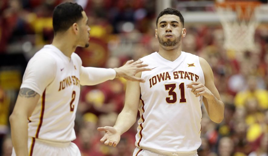 Iowa State forward Georges Niang (31) reacts with teammate Abdel Nader, left, after making a basket during the first half of an NCAA college basketball game against Oklahoma State, Monday, Feb. 29, 2016, in Ames, Iowa. (AP Photo/Charlie Neibergall)