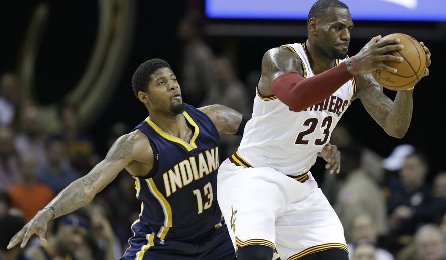 Indiana Pacers' Paul George (13) keeps a close watch on Cleveland Cavaliers' LeBron James (23) in the first half of an NBA basketball game Monday, Feb. 29, 2016, in Cleveland. (AP Photo/Tony Dejak)