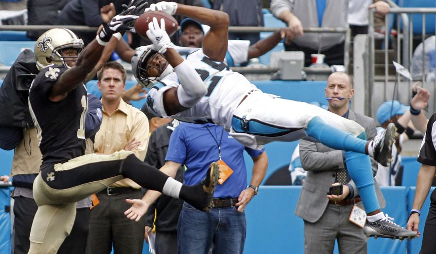 FILE - In this Sept. 27, 2015, file photo, Carolina Panthers' Josh Norman, right, intercepts a pass in front of New Orleans Saints' Brandin Cooks during the second half of an NFL football game in Charlotte, N.C. The Panthers have until Tuesday, March 1, 2016, to put the franchise tag on All-Pro cornerback Josh Norman, a move that is expected while the team looks to work out a long-term contract.  (AP Photo/Bob Leverone, File)