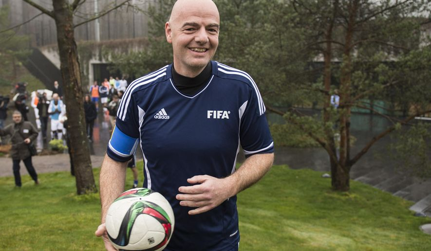 New FIFA President Swiss Gianni Infantino arrives with a ball for a friendly soccer match at the home of FIFA in Zurich, Switzerland, Monday, Feb. 29, 2016. (Ennio Leanza/Keystone via AP)