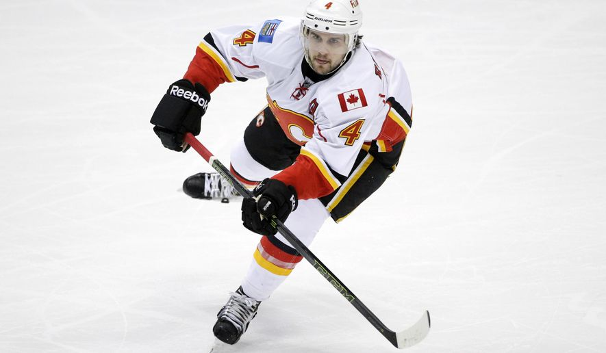 FILE - In this Nov. 24, 2015, file photo, Calgary Flames' Kris Russell moves the puck during the first period of an NHL hockey game against the Anaheim Ducks, in Anaheim, Calif. The Dallas Stars paid a big price to improve their defense, Monday, Feb. 29, 2016,  by acquiring Kris Russell from Calgary. Dallas sent defenseman Jyrki Jokipakka, forward prospect Brett Pollock and a conditional 2016 second-round pick to the Flames. (AP Photo/Jae C. Hong, File)