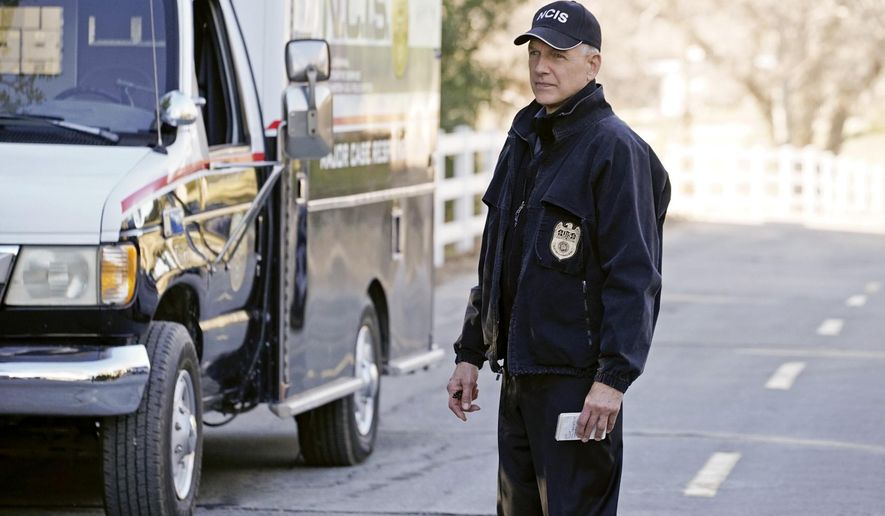 "This image released by CBS shows Mark Harmon in a scene from ""NCIS."" CBS says it has renewed the series for two more seasons, and that series star and executive producer Mark Harmon has signed a new two-year deal of his own. ""NCIS"" premiered in 2003. During the 2009-2010 season, it clinched its status as TV's top-rated scripted drama series. (Jace Downs/CBS via AP)"