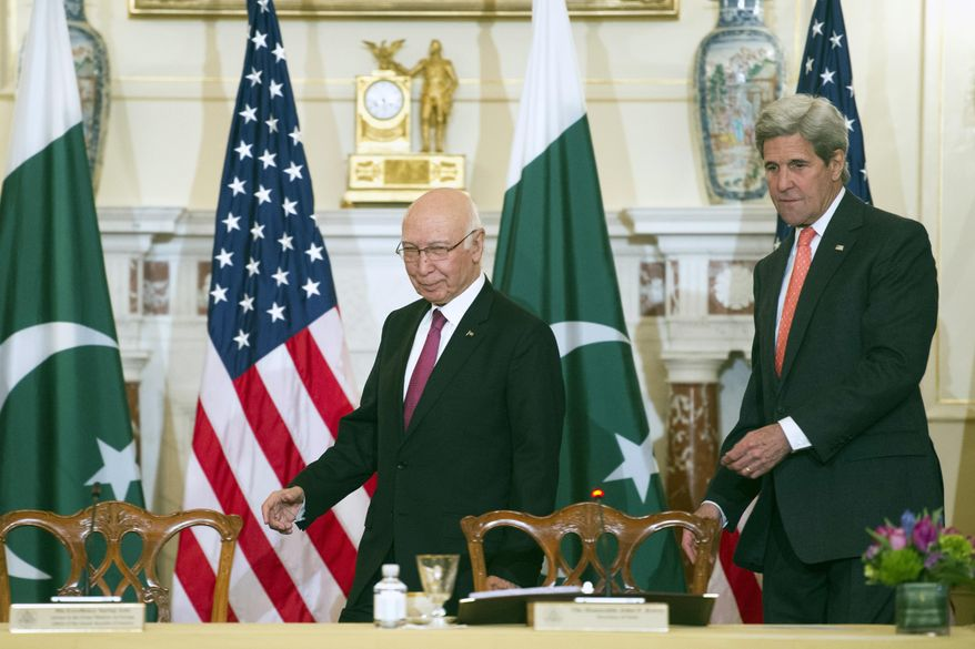 Secretary of State John Kerry and Pakistan Foreign Affairs Adviser Sartaj Aziz, walks to their seats to participate in the U.S.-Pakistan Strategic Dialogue meeting at the State Department in Washington, Monday, Feb. 29, 2016. (AP Photo/Cliff Owen)