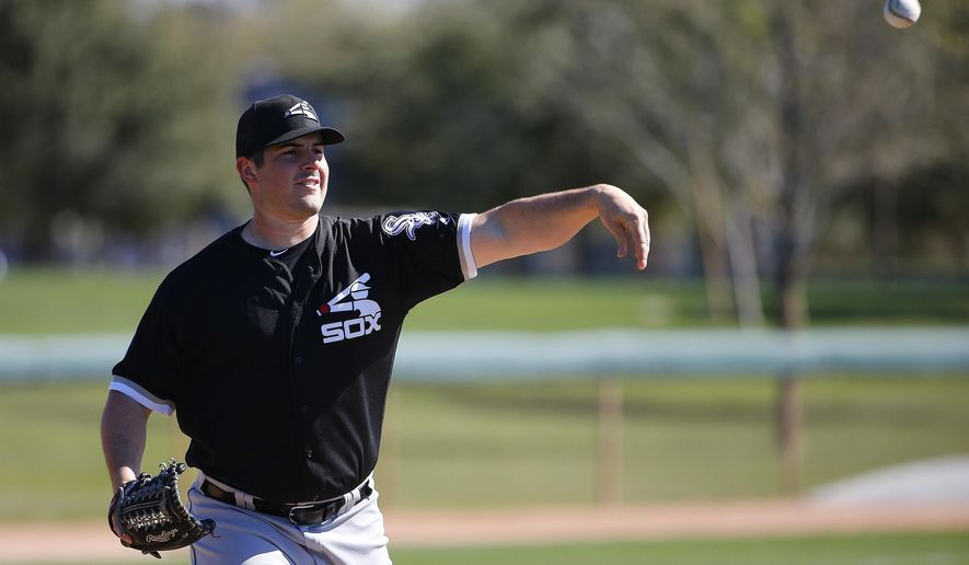 FILE - In this Feb. 24, 2016, file photo, Chicago White Sox's Carlos Rodon throws to first base during a spring training baseball workout, in Glendale, Ariz. One of four lefties in the White Sox rotation, Rodon looks to refine things and improve on a 9-6, 3.75 ERA rookie season.  (AP Photo/Ross D. Franklin, File)