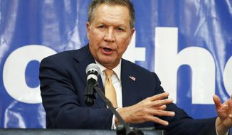 Republican presidential candidate Ohio Gov. John Kasich speaks at a Central Mississippi Republican Party fund raising dinner in Jackson, Miss., Tuesday, March 1, 2016. (AP Photo/Rogelio V. Solis)
