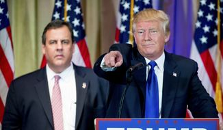 Republican presidential candidate Donald Trump, accompanied by New Jersey Gov. Chris Christie, left, takes questions from members of the media during a news conference on Super Tuesday primary election night in the White and Gold Ballroom at The Mar-A-Lago Club in Palm Beach, Fla., Tuesday, March 1, 2016. (AP Photo/Andrew Harnik) ** FILE **