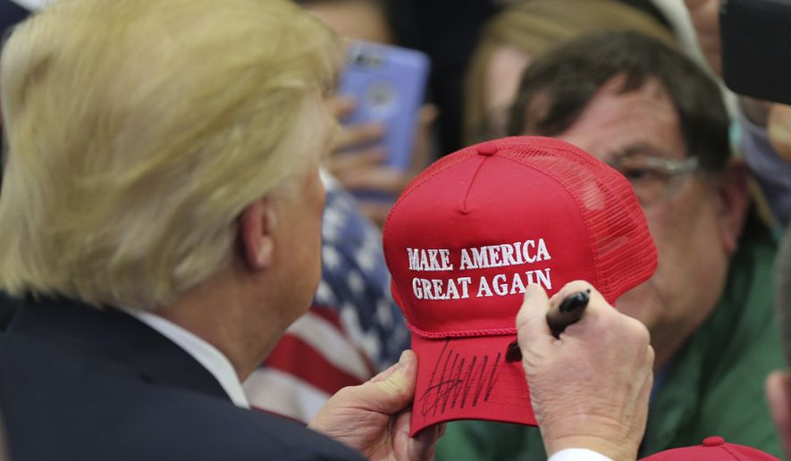 Republican presidential candidate Donald Trump signs an autograph during a rally Tuesday, March 1, 2016, in Louisville, Ky. (AP Photo/John Bazemore)