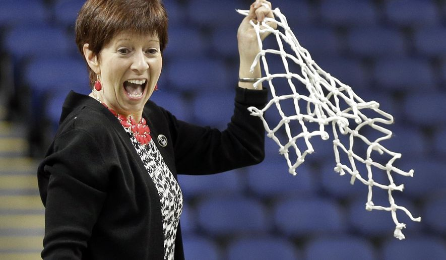 FILE - In this March 8, 2015, file photo, Notre Dame head coach Muffet McGraw reacts after cutting down the net after an NCAA college basketball game against Florida State in the championship of the Atlantic Coast Conference tournament in Greensboro, N.C. The two-time defending champion Fighting Irish (28-1) are once again the team to beat when the tournament starts Wednesday, March 2, 2016.  (AP Photo/Chuck Burton, File)