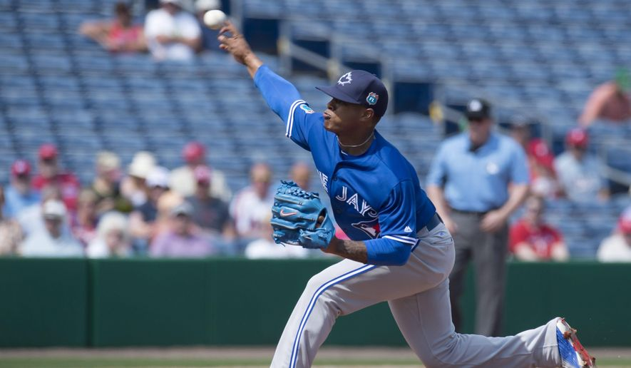 Toronto Blue Jays pitcher Marcus Stroman pitches in the first inning of  a spring training baseball game againt the Philadelphia Phillies, in Clearwater, Fla.,  Tuesday March 1, 2016. (Frank Gunn/The Canadian Press via AP)