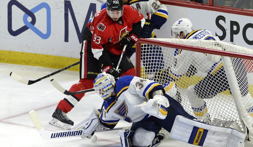 St. Louis Blues goaltender Jake Allen (34) reaches out for the puck as Ottawa Senators' Mika Zibanejad (93) looks for a rebound during the second period of an NHL hockey game, Tuesday, March 1, 2016 in Ottawa, Ontario.  (Justin Tang/The Canadian Press via AP) MANDATORY CREDIT