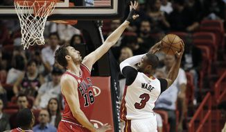 Chicago Bulls Pau Gasol (16) defends the shot by Miami Heat's Dwyane Wade (3) during the first half of an NBA basketball game, Tuesday, March 1, 2016, in Miami. (AP Photo/Joel Auerbach)
