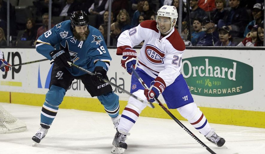 Montreal Canadiens' Victor Bartley (20) clears the puck next to San Jose Sharks' Joe Thornton (19) during the first period of an NHL hockey game Monday, Feb. 29, 2016, in San Jose, Calif. (AP Photo/Marcio Jose Sanchez)