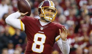 FILE - In this Jan. 10,  2016 file photo, Washington Redskins quarterback Kirk Cousins (8) passes the ball during the first half of an NFL wild card playoff football game against the Green Bay Packers in Landover, Md. The Washington Redskins have placed the franchise tag on Cousins, setting him up to earn about $20 million for next season while still leaving open the possibility of a long-term contract. (AP Photo/Alex Brandon, File)