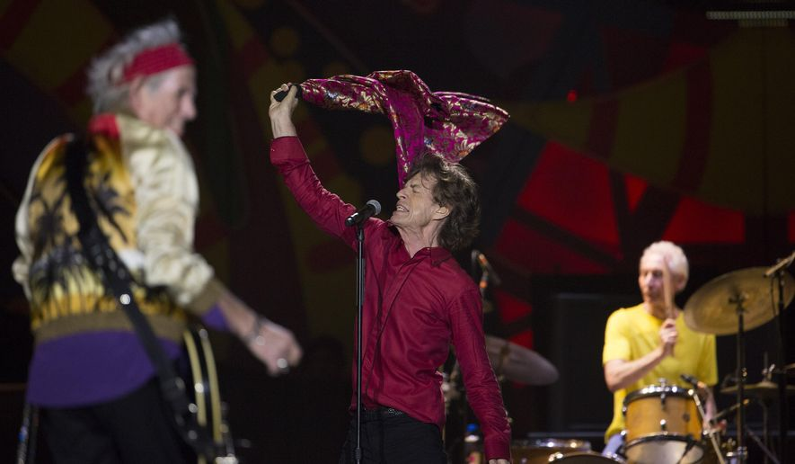 FILE - In this Feb. 20, 2016, file photo, The Rolling Stones' Mick Jagger, Keith Richards, left, and Charlie Watts perform during their Latin America tour, at the Maracana stadium in Rio de Janeiro, Brazil. The Rolling Stones say they will play a free concert in Havana on March 25, becoming the biggest act to play Cuba since its 1959 revolution. (AP Photo/Leo Correa, File)
