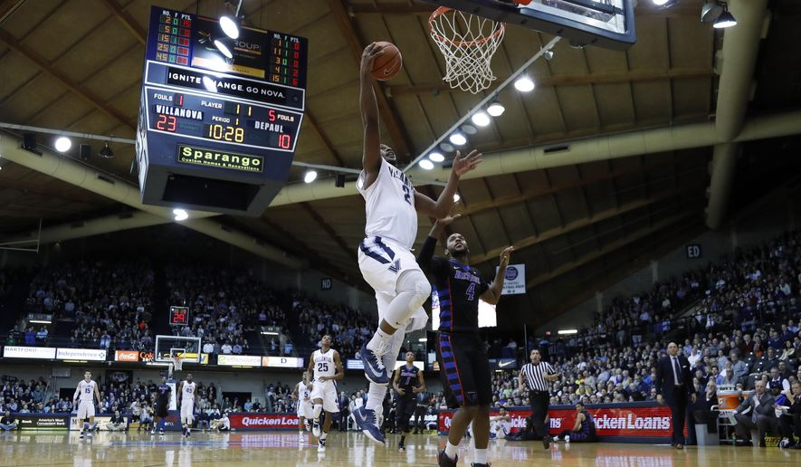 Villanova's Kris Jenkins, left, goes up for a shot against DePaul's Myke Henry during the first half of an NCAA college basketball game, Tuesday, March 1, 2016, in Philadelphia. (AP Photo/Matt Slocum)