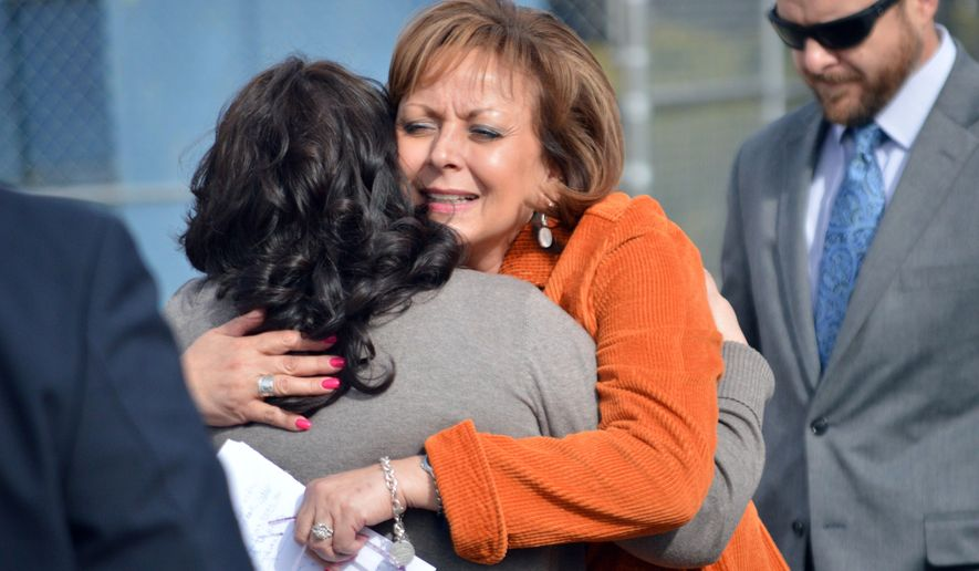 New Mexico Gov. Susana Martinez, center, hugs a family member of a victim of a drunken driving accident, during a press conference in Albuquerque on Tuesday, March 1, 2016. The Republican governor signed a bill Tuesday aimed at strengthening some drunken driving penalties. The bill makes it a second-degree felony to be convicted of eight or more DWIs, meaning tougher sentencing guidelines would be imposed. The measure also substantially increases penalties for convicted drunk drivers involved in fatal crashes. (AP Photo/Russell Contreras)