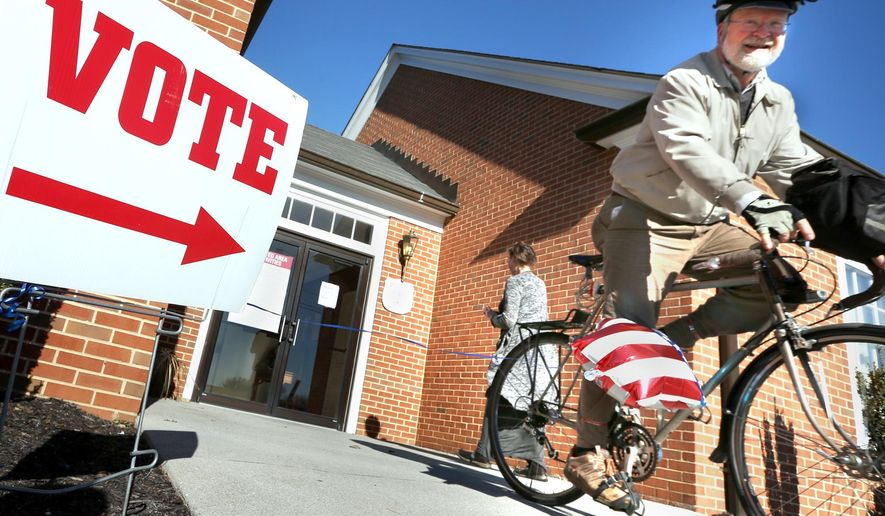 In this file photo, David Ray rides his bike away from his polling place after voting in the primary election Tuesday, March 1, 2016 in Winchester, Va. On Oct. 20, 2016, a federal judge extended the voter-registration deadline in the Old Dominion to Friday, Oct. 21. (Jeff Taylor/The Winchester Star via AP) MANDATORY CREDIT **FILE**
