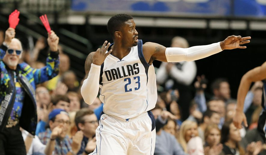 Dallas Mavericks guard Wesley Matthews (23) celebrates sinking a three-point basket in the first half of an NBA basketball game against the Orlando Magic on Tuesday, March 1, 2016, in Dallas. (AP Photo/Tony Gutierrez)
