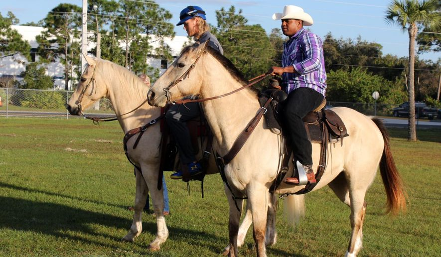 New York Mets' Yoenis Cespedes, right, and Noah Syndergaard ride horses at the team's spring training baseball facility, Tuesday, March 1, 2016, in Port St. Lucia, Fla. (Will Carafello/New York Mets via AP)