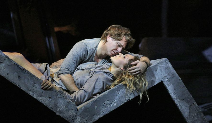 """This image released by the Metropolitan Opera shows Roberto Alagna as Des Grieux, top, and soprano Kristine Opolais as the title character in Puccini's """"Manon Lescaut."""" When tenor Jonas Kaufmann announced he was canceling because of illness less than three weeks before opening night, the Met turned to Alagna to star in Puccini's opera as the Chevalier des Grieux, a student who falls hopelessly in love with the flirtatious Manon. (Ken Howard/Metropolitan Opera via AP)"""