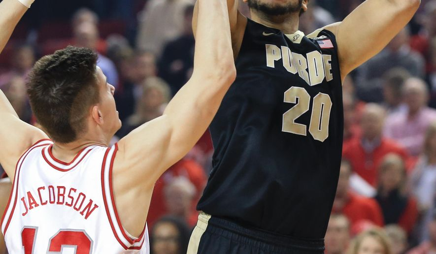 Purdue's A.J. Hammons (20) shoots over Nebraska's Michael Jacobson (12) during the first half of an NCAA college basketball game in Lincoln, Neb., Tuesday, March 1, 2016. (AP Photo/Nati Harnik)