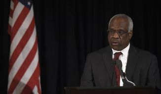 Supreme Court Justice Clarence Thomas speaks at the memorial service for Supreme Court Justice Antonin Scalia, Tuesday, March 1, 2016, at the Mayflower Hotel in Washington. (AP Photo/Susan Walsh, Pool)