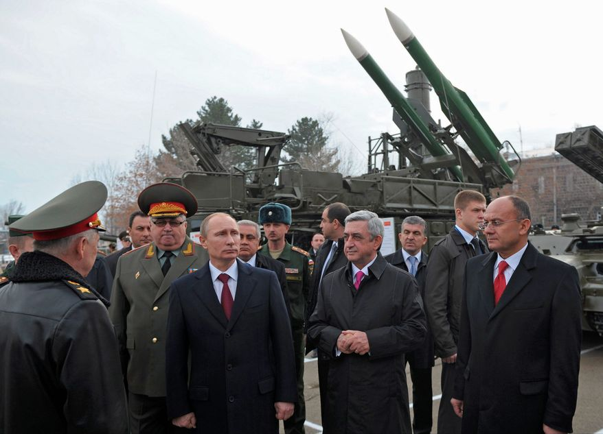 strategic allies: Armenian President Serzh Sarkisian (right) has agreed to let Russian President Vladimir Putin deploy a slew of military vehicles to a base just outside the Armenian capital of Yerevan. (Associated Press)