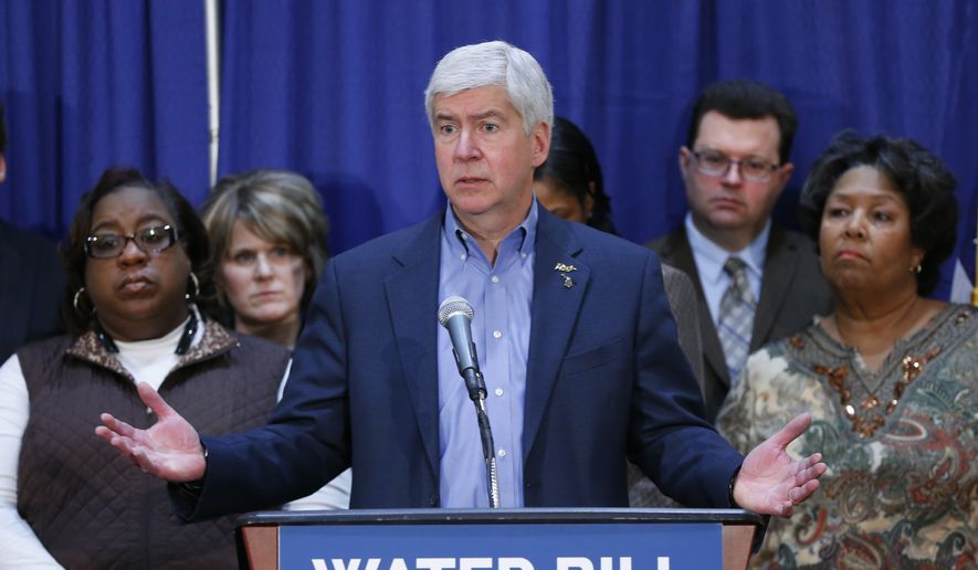 Gov. Rick Snyder speaks after attending a Flint Water Interagency Coordinating Committee meeting in Flint, Mich., in this Feb. 26, 2016, file photo. (AP Photo/Paul Sancya) ** FILE **