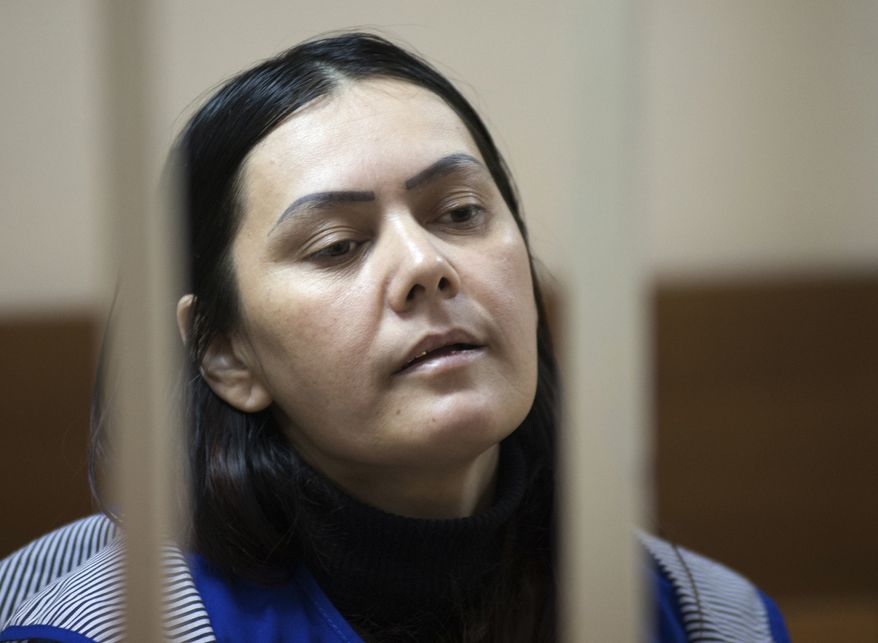 Gulchekhra Bobokulova, a nanny from Uzbekistan, is seen in a court room in Moscow, Russia, Wednesday, March 2, 2016. Russian prosecutors said Wednesday that the nanny accused of killing and then decapitating a 4-year-old girl in Moscow was not acting on her own. (AP Photo)