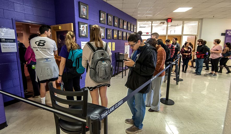 People line up to vote at the new Harrisonburg, Va., voting precinct for the primary election at James Madison University's Convocation Center on March 1, 2016. (Austin Bachand/Daily News-Record via AP)