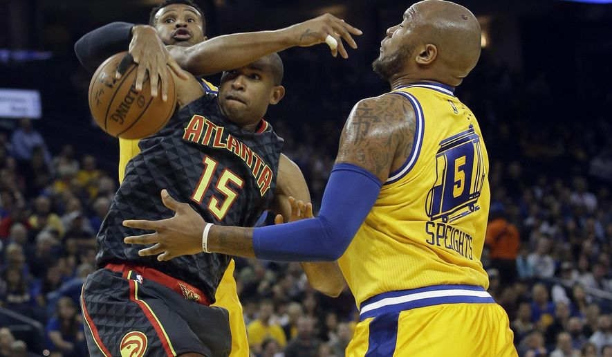 Atlanta Hawks' Al Horford (15) grabs a rebound between Golden State Warriors' Leandro Barbosa, left, and Marreese Speights (5) during the first half of an NBA basketball game Tuesday, March 1, 2016, in Oakland, Calif. (AP Photo/Marcio Jose Sanchez)